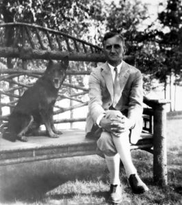 Mont Tennes with his dog Wolf at Sunset Point c. 1930s