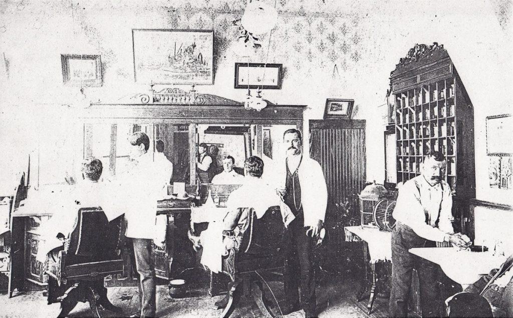 The Jasper Roderick Barbershop. Jasper Roderick in center, circa 1910s.