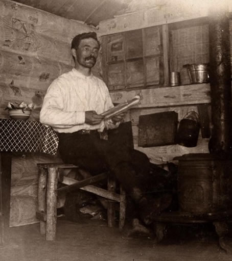Grant Cook in his homestead on Moccasin Lake, west of Land O'Lakes, circa 1898.
